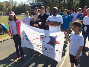 Special Olympics Holding School Flag